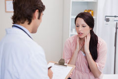 Doctor having conversation with patient Stock Photos