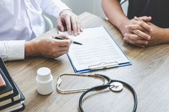 Doctor having conversation with patient while discussing explaining symptoms or counsel diagnosis health and consult treatment of. Disease, healthcare and stock images