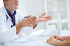 Doctor is having conversation with patient royalty free stock photos