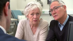Doctor Having Discussion With Senior Couple In Surgery stock footage