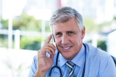 Doctor having phone call Stock Images