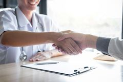 Doctor having shaking hands to congrats with patient after recommend treatment while discussing explaining his symptoms and. Counsel diagnosis health stock photos