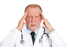 Doctor with headache Royalty Free Stock Photo