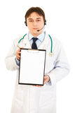 Doctor with headset holding blank clipboard Royalty Free Stock Photos