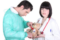 Doctor healing teddy bear Stock Images