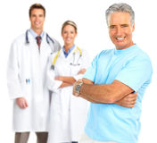 Doctor and healthy elderly man Royalty Free Stock Images