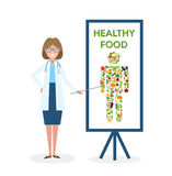 Doctor with healthy food banner. Nutritionist shows how to eat clean and fresh food. Freen vegetables for body. Human silhouette Royalty Free Stock Photography