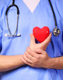 Doctor with heart expressing care Stock Photo