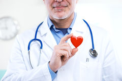 Doctor with heart Stock Photography