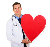 Doctor heart shape. Smiling medical doctor with heart shape isolated on white background Stock Images