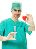 Doctor with a heart and  syringe in his hand Royalty Free Stock Photography