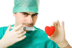 Doctor with a heart and  syringe in his hand Royalty Free Stock Photos