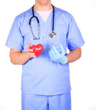 Doctor with heart and syringe, isolated Royalty Free Stock Image