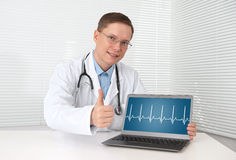Doctor with hearts beat diagram stock photo