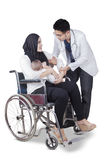 Doctor helping disabled mother Stock Photo