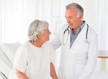 Doctor helping his patient to walk Royalty Free Stock Image