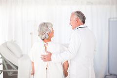 Doctor helping his patient to walk Royalty Free Stock Photo