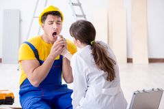 The doctor helping injured worker at construction site Royalty Free Stock Photos