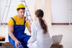 The doctor helping injured worker at construction site Stock Photography