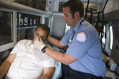 Doctor Helping Man With Oxygen Mask Stock Image