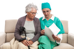 Doctor helping old injured woman Royalty Free Stock Photography
