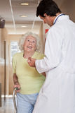 Doctor helping Patient use Walking Stick Royalty Free Stock Photo