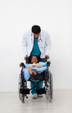 Doctor helping a sick child Royalty Free Stock Images