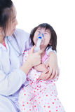 Doctor helps little girl to do inhalation Royalty Free Stock Photos