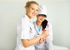 Doctor with her assistant Stock Photo