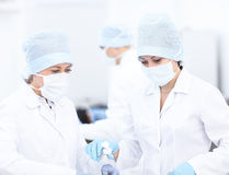 Doctor and her assistent during operation royalty free stock photos