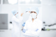 Doctor and her assistent during operation Stock Photography