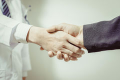 Doctor and her lawyer shaking hands , vintage Royalty Free Stock Image