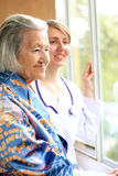 Doctor and her patient smiling. Care, nurse Stock Images