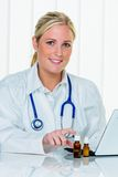 Doctor in her practice. A young doctor at the surgery in their medical practice Stock Photo