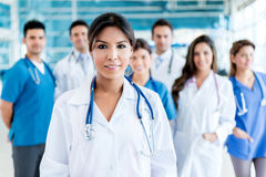 Doctor with her team Stock Photography
