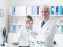 A doctor with his assistant in the office Royalty Free Stock Photos