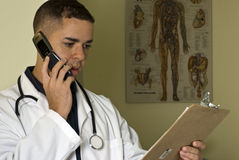 Doctor on his Cell Phone Royalty Free Stock Photo
