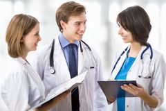Doctor with his colleagues Stock Image