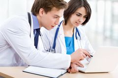 Doctor and his collegue Stock Images