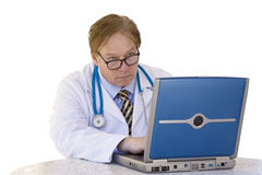 Doctor at his computer. The doctor looks up from his computer to speak with you Royalty Free Stock Image