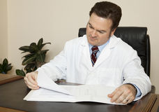 Doctor at his Desk Royalty Free Stock Image