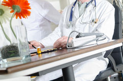 Doctor at his desk in medical office Stock Photography