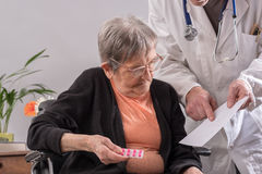 Doctor and his elderly female patient Stock Photo