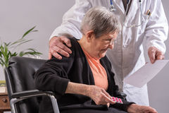 Doctor and his elderly female patient Stock Images