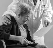 Doctor and his elderly female patient Stock Image