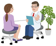 Doctor and his female patient at his office Stock Photography