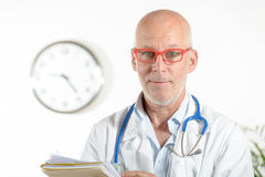 A doctor in his office Stock Images