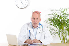 A doctor in his office Royalty Free Stock Photo