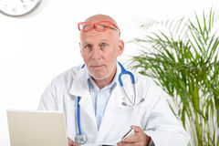 A doctor in his office Stock Image