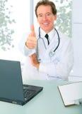 doctor his office senior sit стоковое фото